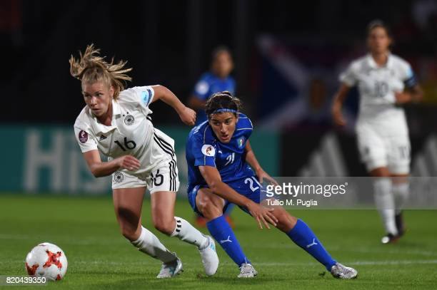 Linda Dallmann of Germany holds off the challenge from Marta Carissimi of Italy during the UEFA Women's Euro 2017 Group B match between Germany and...