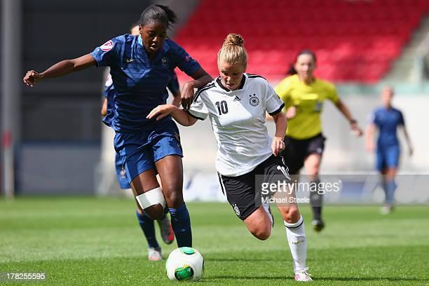 Linda Dallmann of Germany U19 women is held up by Aissatou Tounkara of France U19 women during the UEFA Women's U19 Semi Final match between Germany...