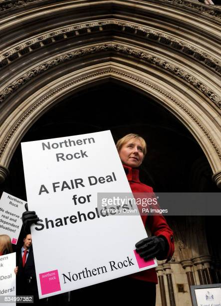 Linda Dixon from South Shields poses as shareholders from Northern Rock protest outside the High Court in London