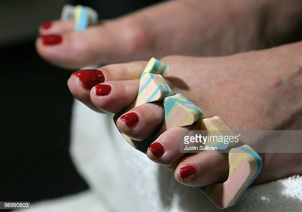 Linda DonlyReid sits as the nail polish on her toes dries after having a pedicure at JT Nails March 3 2006 in San Francisco California Assembly...