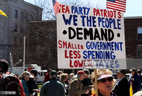 Linda Dupere holds a sign at a Tea Party tax day rally April 15 2011 outside the Statehouse in Concord New Hampshire The event brought former...