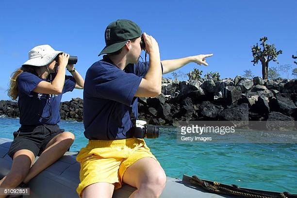 Linda Elliott Left And Heidi Stout Of The International Fund For Animal Welfare Inspect The Shoreline Of Santa Fe Island In The Galapagos Archipelago...