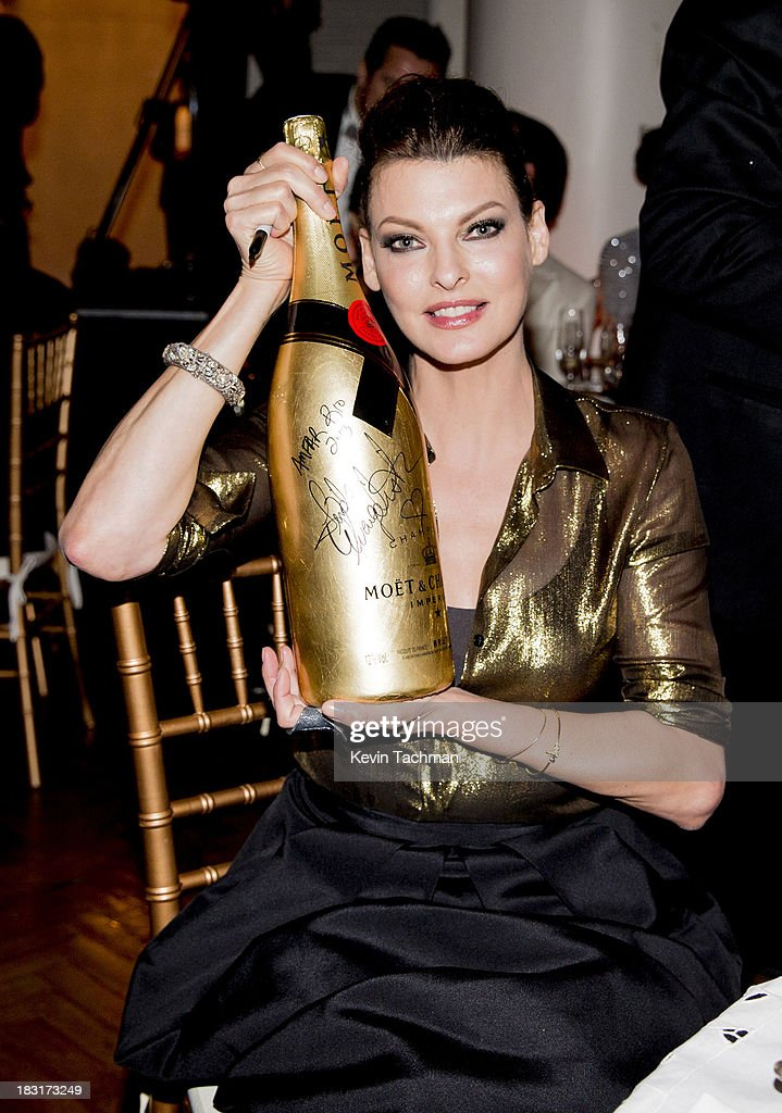 <a gi-track='captionPersonalityLinkClicked' href=/galleries/search?phrase=Linda+Evangelista&family=editorial&specificpeople=203121 ng-click='$event.stopPropagation()'>Linda Evangelista</a> presents a bottle of Moët & Chandon Impérial Gold-Leaf Jeroboam at the amfAR Inspiration Gala Rio on October 4, 2013 in Rio de Janeiro, Brazil.