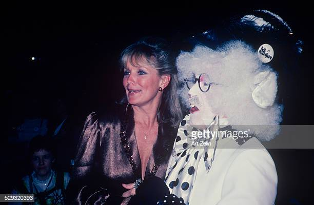 Linda Evans wearing taupe with a person dressed as a rabbit circa 1970 New York