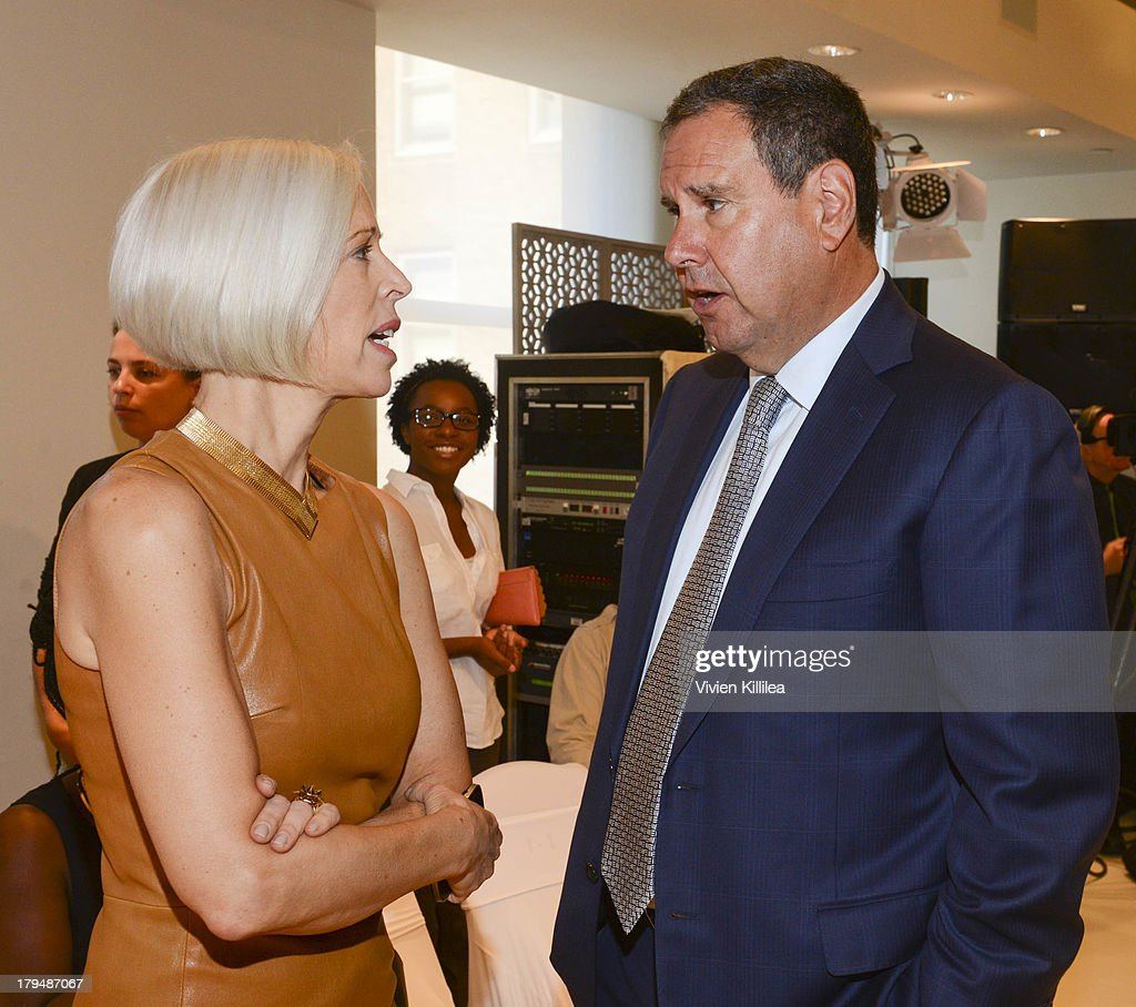 <a gi-track='captionPersonalityLinkClicked' href=/galleries/search?phrase=Linda+Fargo&family=editorial&specificpeople=592060 ng-click='$event.stopPropagation()'>Linda Fargo</a> and Managing Director at Bank of America Steve Sadoff attend the Josie Natori show during Mercedes-Benz Fashion Week Spring 2014 on September 4, 2013 in New York City.