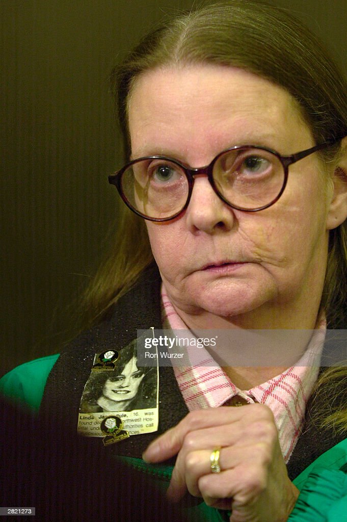 Linda G. Rule wears a small photo of her daughter, Linda Jane Rule, who was killed by mass murderer Gary Ridgway, known as the Green River Killer December 18, 2003 in Seattle, Washington. Ridgway was sentenced to life in prison without the chance of release in King County Superior Court.
