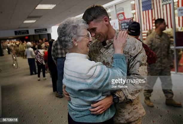 Linda Goodale joins members of the Maine Troop Greeters as she meets her grandson US Marine Lt Jason Goodale as he passes through the Bangor...