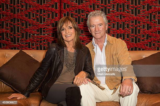 Linda Gray and Patrick Duffy pose at the launch of 'Dallas' on Foxtel's SoHo at The Loft on August 19 2014 in Sydney Australia