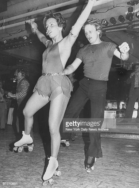 Linda Gyenese and partner dance on roller skates at Ice Palace discotheque