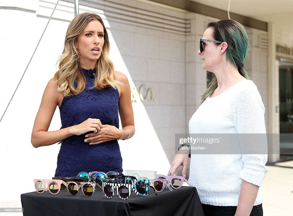 Linda Hammond (R) creator of Key Australia with host Renee Bargh as EXTRA shows off the latest Spring/Summer Sunglass trends at Westfield Century City on May 13, 2014 in Los Angeles, California.