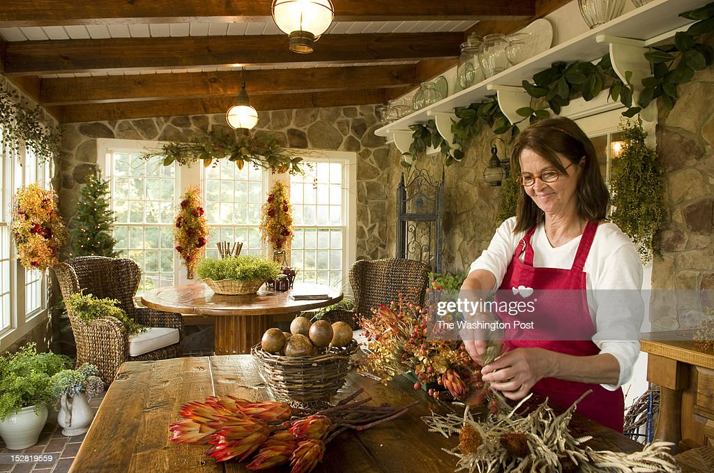 Linda Hobbins crafts a wreath while working inside of the carriage house at home in Potomac Maryland on August 29 2012 The carriage house is the...