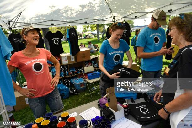 Linda Hofer left Lilly O'Leary and her brother Connor right can barely keep up with demand for their eclipse related tshirts coasters coffee mugs...