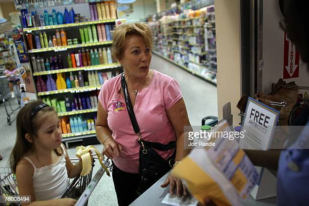 Linda Hoffman and her granddaughter Riley Bulnes pick up their free prescription of antibiotics from Rosemary Petty a Publix Supermarket pharmacy...