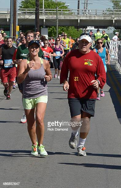 Linda Holiday in her first hometown 1/2 Marathon is supported by fiance NFL New England Patriots head coach Bill Belichick on April 26 2014 in...