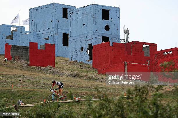 Linda Indergand of Switzerland races during the Women's CrossCountry Mountain Bike Race on Day 15 of the Rio 2016 Olympic Games at the Mountain Bike...