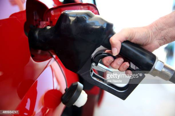 Linda Jacobsen pumps gas at the Victory gas station on April 21 2014 in Pembroke Pines Florida According to the Lundberg Survey the average price for...