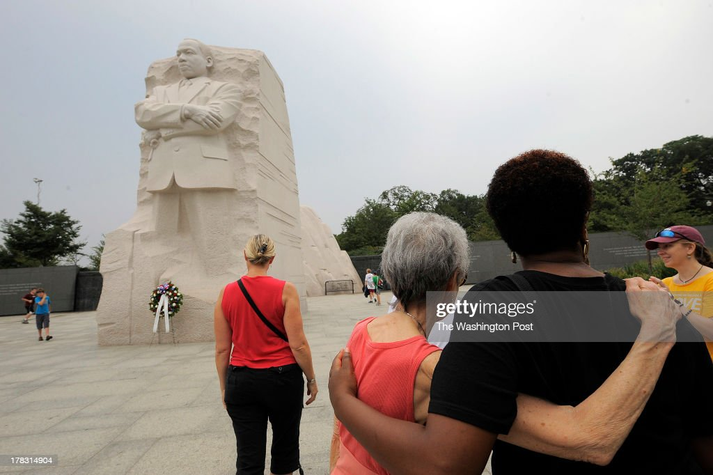 Linda Kacser, right center, embraces, C.Y. Christian, right, at the Martin Luther King, Jr. Memorial prior to events commemorating the 50th anniversary of the March on Washington on Wednesday August 28, 2013 in Washington, DC.
