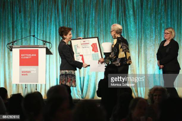 Linda Lee and Joan Rose hold award on stage at the Bottomless Closet Spring Luncheon at Cipriani 42nd Street on May 17 2017 in New York City