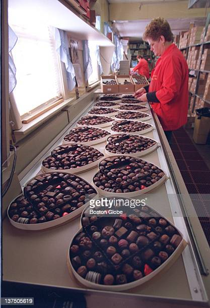 Linda MacKenzie packs Valentine's Day chocolates into heartshaped boxes at Phillips Candy House