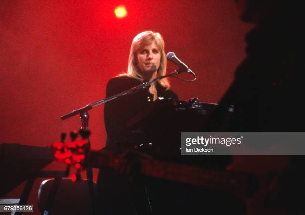 Linda McCartney performing on stage with Paul McCartney at Wembley Arena London 11 January 1990