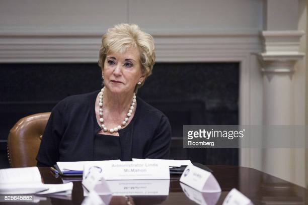 Linda McMahon administrator of the Small Business Administration listens during a meeting with military spouses in the Roosevelt Room of the White...