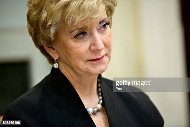 Linda McMahon administrator of the Small Business Administration listens while meeting with women small business owners with US President Donald...
