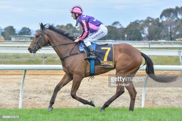 Linda Meech returns to the mounting yard on Moss 'n' Bolt after winning the Gippsland Grain Store Maiden Plate at Bairnsdale Racecourse on October 08...
