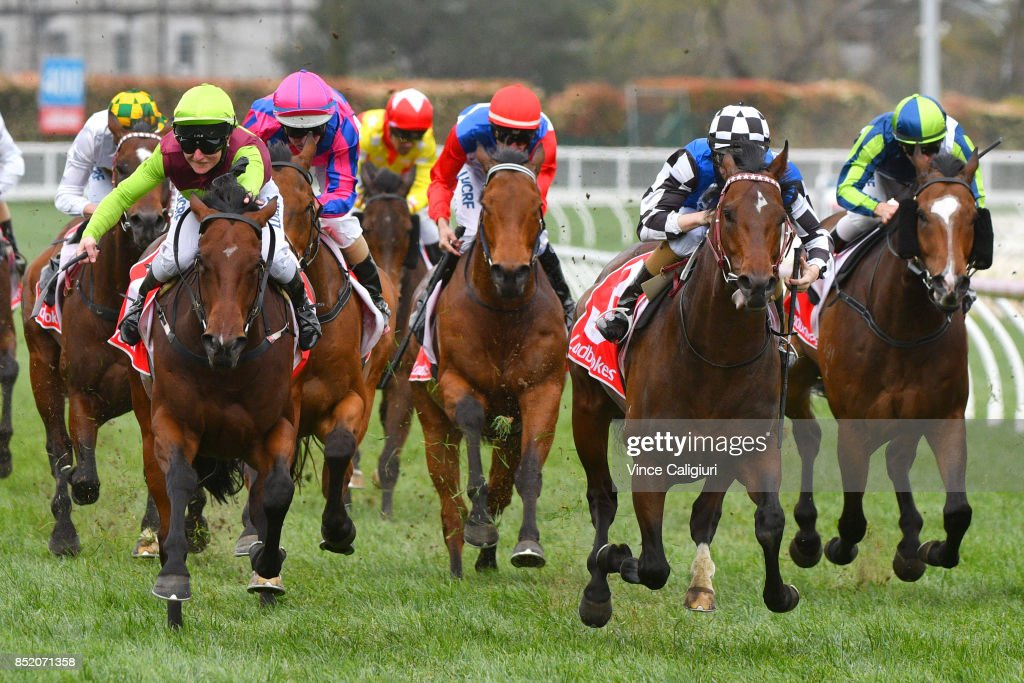 Linda Meech riding Bons Away defeats Damian Lane riding Brave Smash in Race 6 Testa Rossa Stakes during Melbourne Racing at Caulfield Racecourse on September 23, 2017 in Melbourne, Australia.