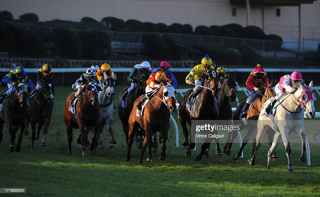 Linda Meech riding Smoken Cash leads the field into the straight in The Peak 0-89 Handicap during Melbourne Racing at Moonee Valley Racecourse on June 29, 2013 in Melbourne, Australia.