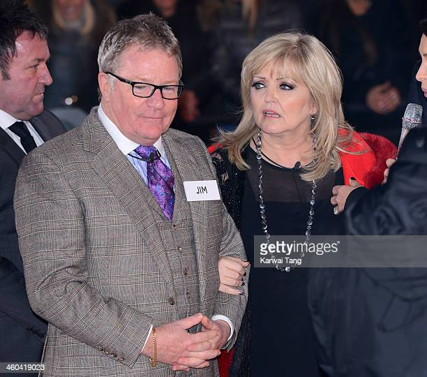 Linda Nolan and Jim Davidson enter the Celebrity Big Brother House at Elstree Studios on January 3 2014 in Borehamwood England