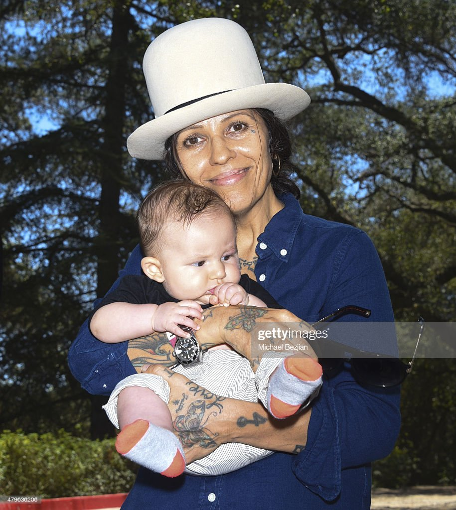 Linda Perry and son Rhodes Emilio Gilbert Perry attend Peak Mind Foundation Hosts A Talk With His Holiness The 14th Dalai Lama at Rancho Las Lomas on July 4, 2015 in Silverado Canyon, California.