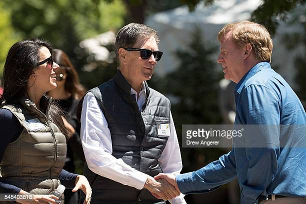 Linda Pizzuti Henry looks on as John Henry owner of the Boston Red Sox baseball franchise and owner of Liverpool FC soccer club shakes hands with...