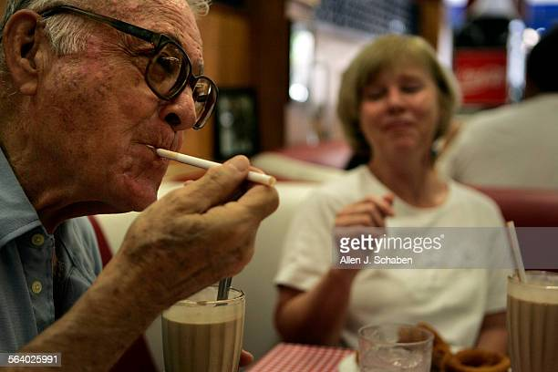 Linda Polese rightof Fountain Hills AZ enjoys a chocolate shake with her father Alson Frazer left of Santa Ana at Watson's Drug Store in Orange...