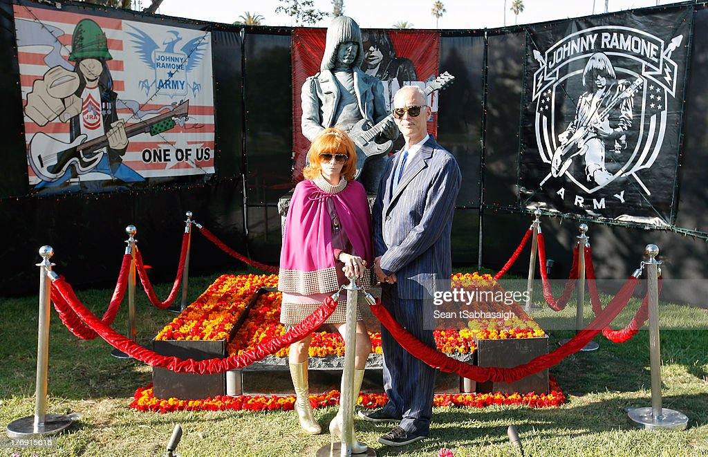 <a gi-track='captionPersonalityLinkClicked' href=/galleries/search?phrase=Linda+Ramone&family=editorial&specificpeople=5476133 ng-click='$event.stopPropagation()'>Linda Ramone</a> (L) and director <a gi-track='captionPersonalityLinkClicked' href=/galleries/search?phrase=John+Waters+-+Director&family=editorial&specificpeople=209202 ng-click='$event.stopPropagation()'>John Waters</a> (Rt) pose in front of Johnny Ramone bronze statue at the 9th Annual Johnny Ramone Tribute at Hollywood Forever on August 18, 2013 in Hollywood, California.