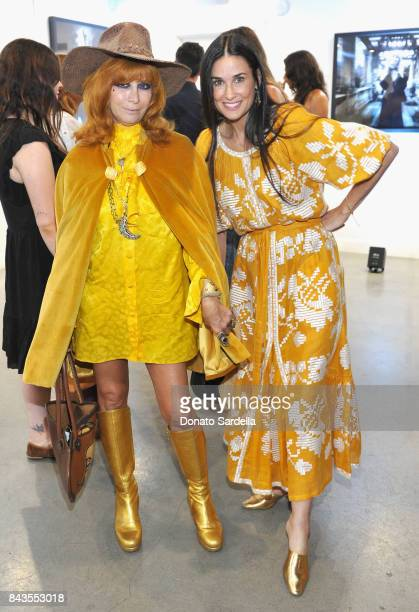 Linda Ramone Demi Moore and celebrity floral and fragrance designer Eric Buterbaugh attend the private opening of Sascha von Bismarck debut...
