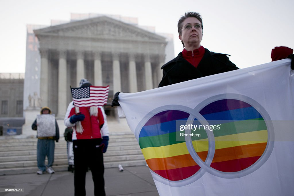 Linda Sanderson holds a rainbow flag outside the U.S. Supreme Court in Washington, D.C., U.S., on Tuesday, March 26, 2013. The Supreme Court takes up what is probably its biggest civil-rights dispute in decades this week when it hears arguments that could lead to the legalization of same-sex marriage nationwide. Photographer: Andrew Harrer/Bloomberg via Getty Images