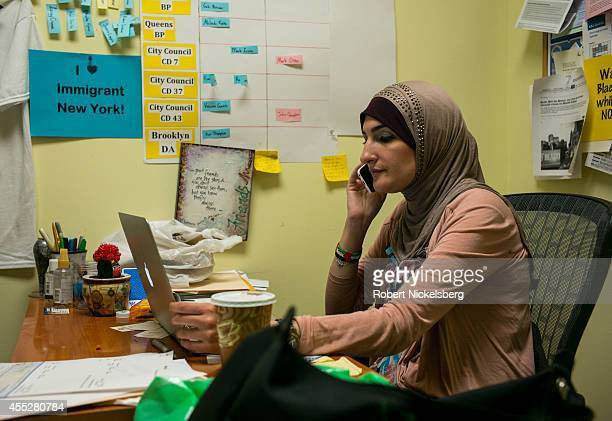 Linda Sarsour executive director of the ArabAmerican Association of New York speaks over the phone September 11 2014 in the Brooklyn borough of New...