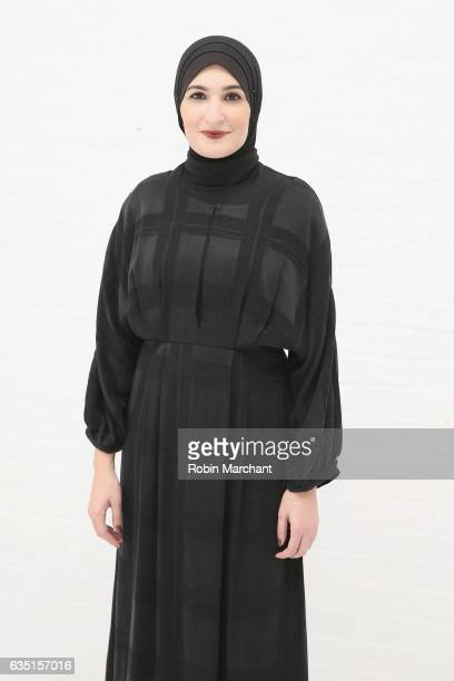 Linda Sarsour poses before the Mara Hoffman collection during New York Fashion Week The Shows at Shop Studios on February 13 2017 in New York City