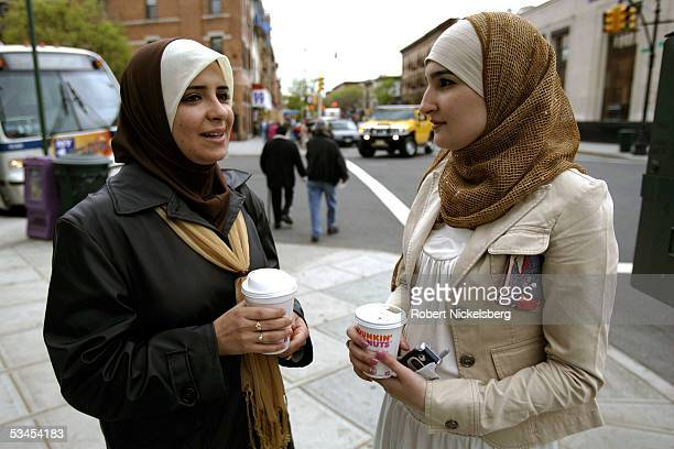 Linda Sarsour Program Director for the Arab American Association of New York speaks to coworker Muna Irziqat on May 22005 in New York City Muna came...