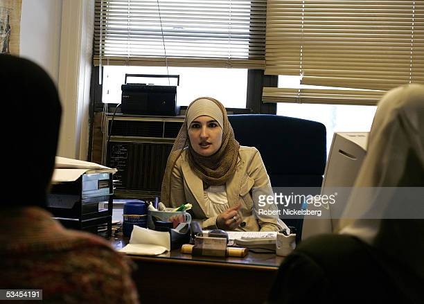 Linda Sarsour Program Director for the Arab American Association of New York advises two Arab women on May 5 2005 in New York City Linda is an ethnic...