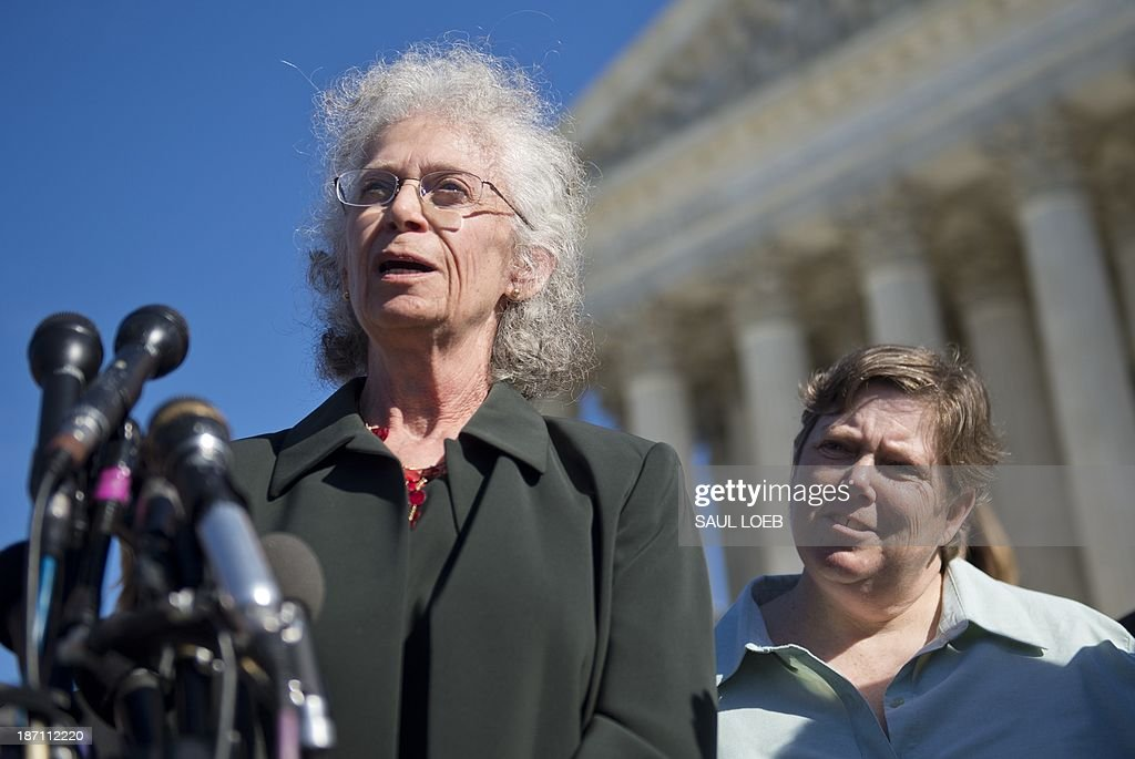 Linda Stephens (L), an atheist, speaks to the media alongside co-plaintiff Susan Galloway (R), who is Jewish, following oral arguments in the case of Town of Greece v. Galloway dealing with prayer in government outside the Supreme Court in Washington, DC, November 6, 2013. The two brought a case against the town of Greece, New York, after the town began saying a prayer prior to the monthly public meetings and the Court will determine if that violates the Constitution by endorsing a single faith. AFP PHOTO / Saul LOEB