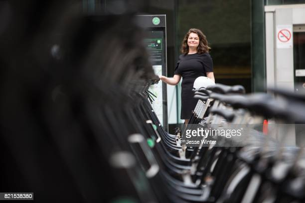Linda Swanston a project lead with the City of Toronto's Environment and Energy division poses for a photo with her bicycle outside Metro Hall...