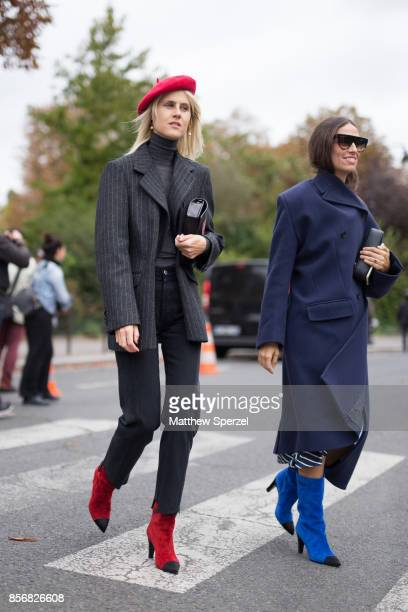 Linda Tol and Erika Boldrin are seen attending Sacai during Paris Fashion Week wearing Sacai on October 2 2017 in Paris France