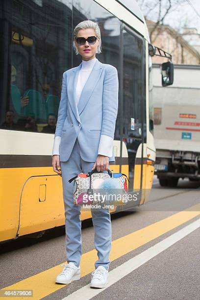 Linda Tol carries a Fendi bag and wears Acne sneakers on February 26 2015 in Milan Italy
