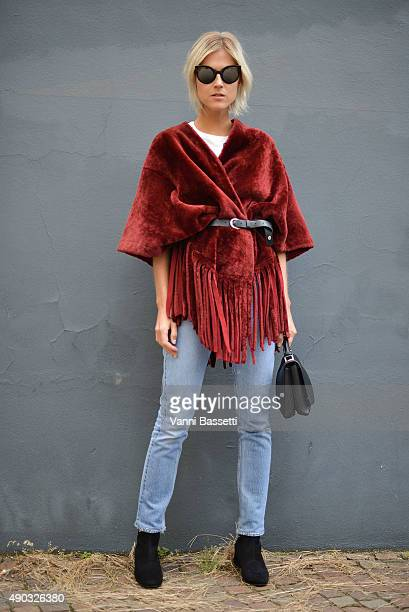 Linda Tol poses wearing a Drome coat before the MSGM show during the Milan Fashion Week Spring/Summer 16 on September 27 2015 in Milan Italy