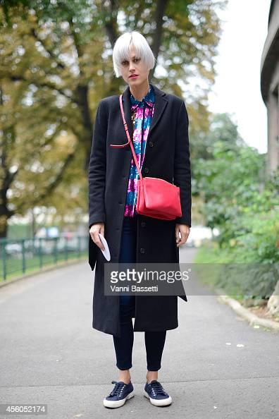 Linda Tol poses wearing a Filippa K coat Filles a Papa shirt Ayr pants Cline bag and Superga shoes on September 24 2014 in Paris France