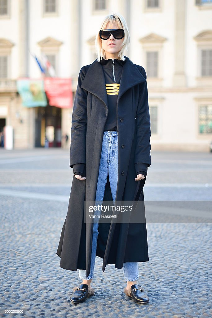 Linda Tol poses wearing a Ganni top, Max Mara coat and Gucci shoes before the Costume National show at Piazza del Duomoduring the Milan Men's Fashion Week Fall/Winter 2016/17 on January 16, 2016 in Milan, Italy.