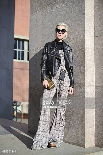 Linda Tol poses wearing a Just Cavalli dress Acne jacket Zagliani clutch and Charlotte Olympia phone case on February 26 2015 in Milan Italy