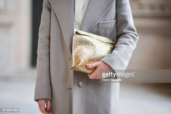 Linda Tol poses wearing a Stella McCartney coat Ganni shirt Paul and Joe pants and Loewe clutch after the Shiatzy Chen show at the Grand Palais...