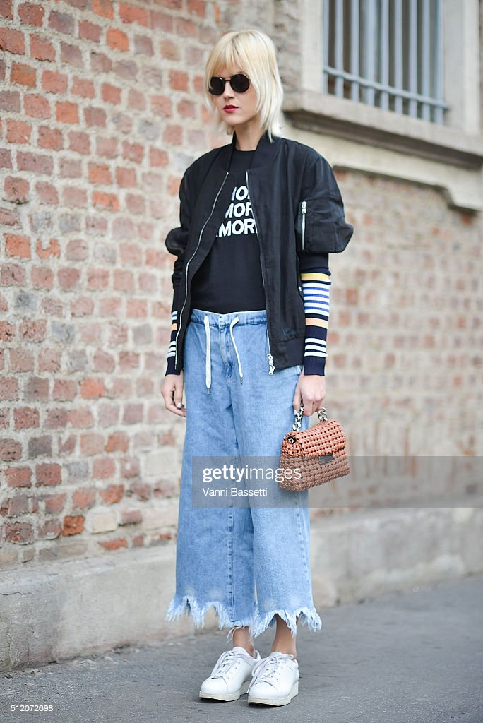 Linda Tol poses wearing Diesel Black Gold jacket An Italina Theory shirt Zara pants and Acne Studios shoes before the Alberta Ferretti show during...